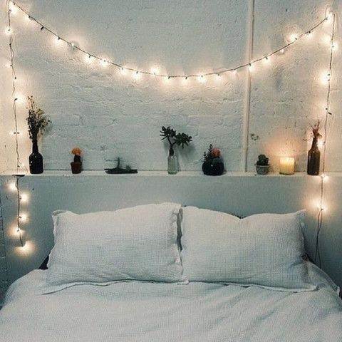 Fairy lights in bedrooms | Bedrooms V Lights – Around the bed head. Classic and simple to execute. Candles, plants, brick walls and a perfect little ledge ripe and ready for a glass of wine. Copper and Cross