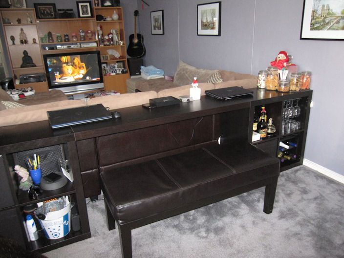 IKEA Hackers: EXPEDIT sofa table/bar/computer desk..... Couch table behind the couch in IL, open like this with a bench or two stools to slide all the way underneath. More seating, out of the way unless needed.