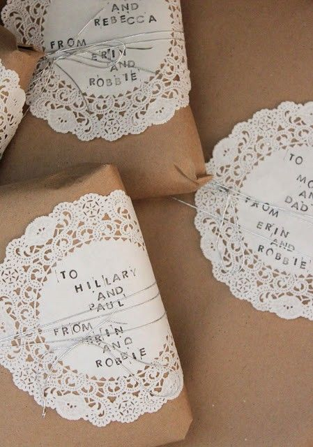 paper doilies as gift tags. Like these especially, when contrasted with the plain brown paper and wrapped around the gift with string. Pretty and simple.