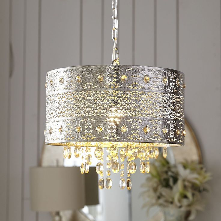 Lighting is an artful endeavor, especially in the case of our bejeweled chandelier. Influenced by modern bohemian styling, our gleaming, metallic chandelier features a punched floral pattern and warm amber crystal beads and drops.