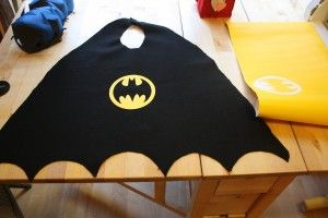 Batman capes made out of felt! 2 yards at craft store then find a cape pattern and use velcro for neck!