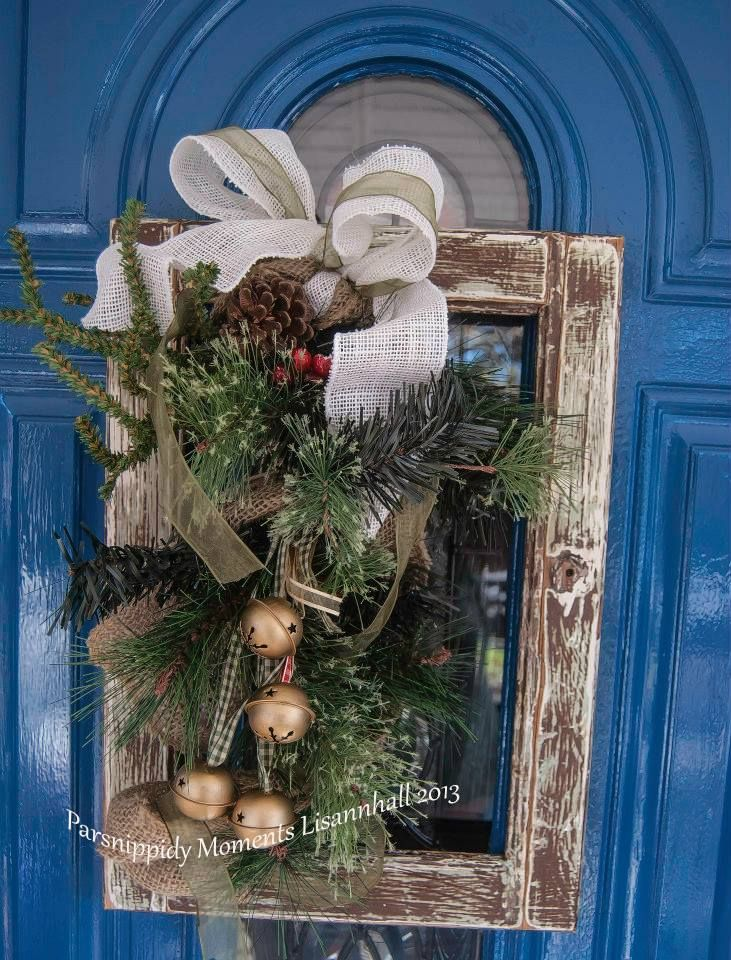 """Rustic Christmas Wreath Every year I try to create wreaths that are not your average everyday round wreath with greenery. One of my favorites for this year is my """"door"""" wreath. It is made from an old cabinet door, a little greenery, some ribbons and bells, and of course, burlap!"""