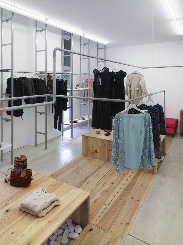 // Concrete & wood - harmony     Vainilla & Chocolate store by Salgado E Liñares Arquitectos, La Coruña