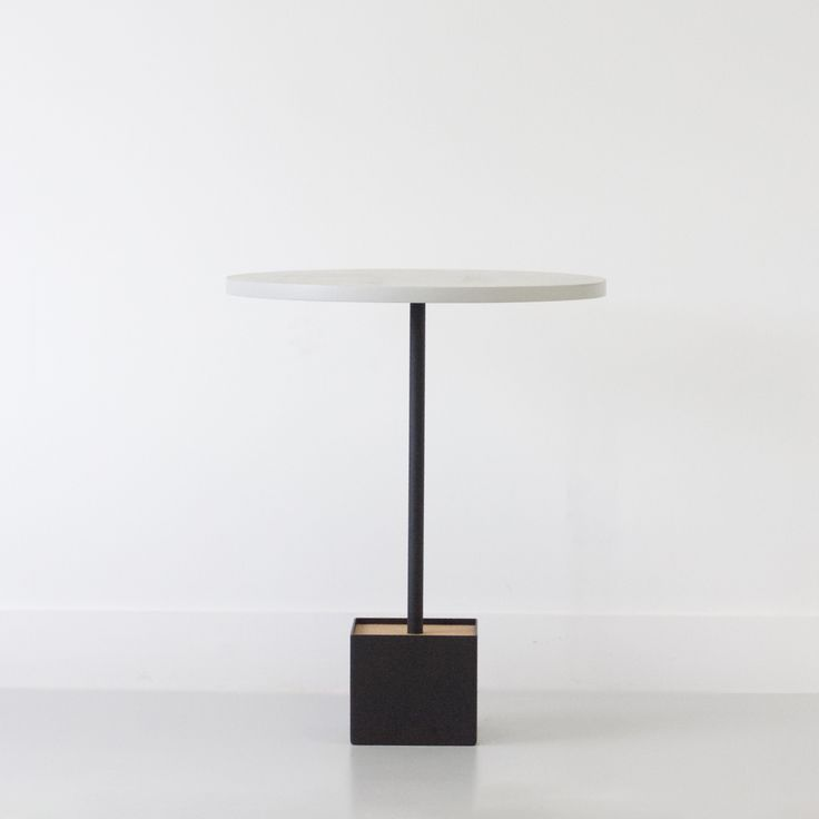 Plante | Cafe or Bistro table for modern environments. Inspired by plant life, the table sits atop a stem that rises from a planter like base. Features an inset cork insert that is customizable.