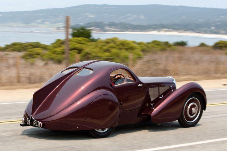 1931 Bugatti Type 51 Dubos Coupe.  Looks like the California coastline in the back ground.  Miss my California…..