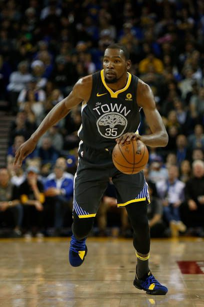 6ae58a58d57b Kevin Durant of the Golden State Warriors dribbles the ball up court  against the Denver Nuggets at ORACLE Arena on December 23 2017 in Oakland.