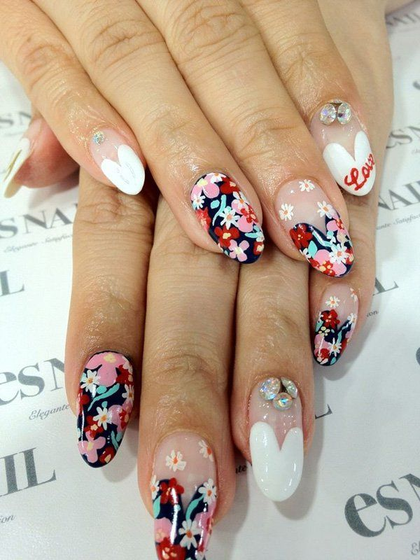 The playful flowers that dance around the nails are so pretty to look at. The blue background acrylic does well to emphasize the colorful flowers that have been splattered all over the nails. The white tips help deviate from all the flower noise and keeps a clean look for the nails.