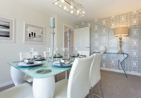 Modern interior designed dining room, using pale aqua, silver & taupe colour scheme.