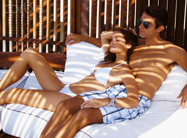 Couple relaxing on chaise lounge