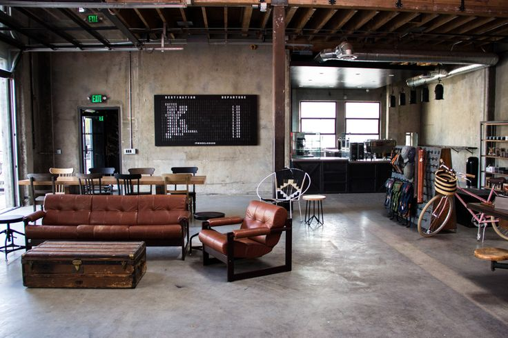 Industrial style living room with vintage furniture and leather accents