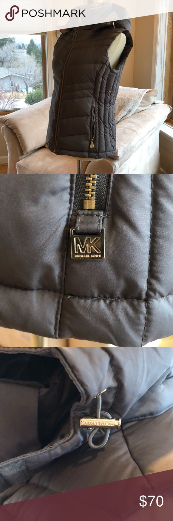 Michael Kors puffy vest Brand new WOT , never been worn . Beautiful light brownish gray color. Gold accents. Hood can be removed . Purchased at Nordstrom's . Michael Kors Jackets & Coats Vests