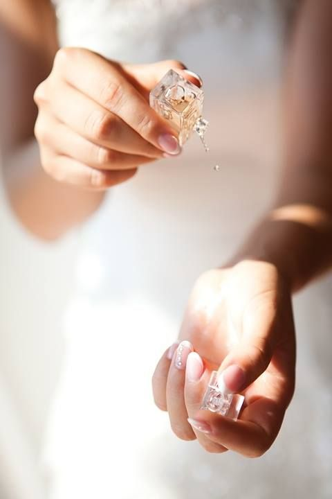 A glamorous woman applies perfume where her heart pulses, which increases the scent....