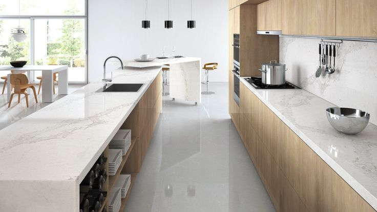 Caesarstone calacatta nuvo. Want to check this out for future kitchen. Supposed to look like marble but non-staining.