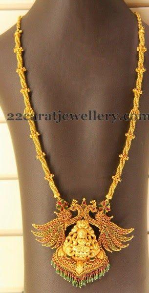 Jewellery Designs: Antique Trendy Peacock and lakshmi pendant