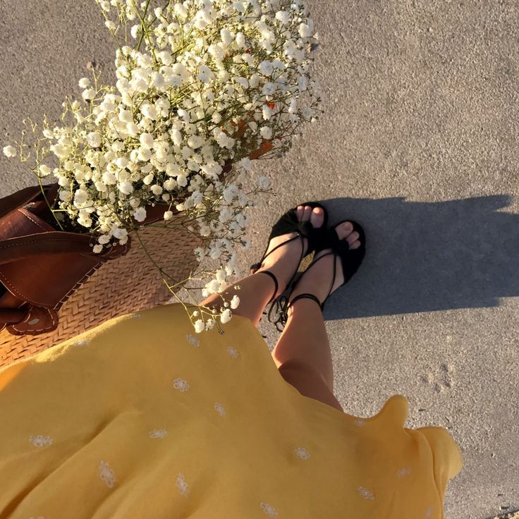 """Heading to the farmers market in the sunny yellow Chiquita Dress and our FL&L X MARAIS strappy sandals."""