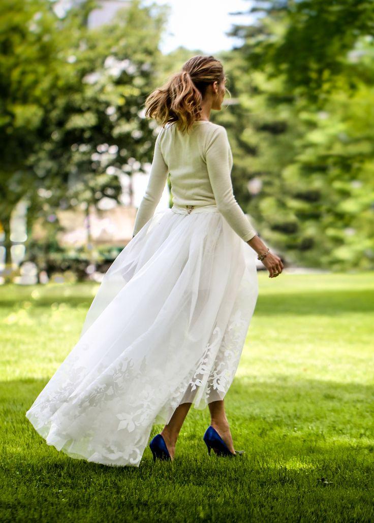 Olivia Palermo you No.1 stunner - Cashmere sweater, shorts and a tulle skirt (Carolina Herrera Wedding Dress). How amazing!