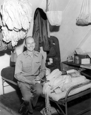 """First Lieutenant Gail Halvorsen, USAF, became famous for """"Operation Little Vittles."""" He rigged miniature parachutes with American candy bars and gum and then dropped the parachutes over Berlin for German children to retrieve."""