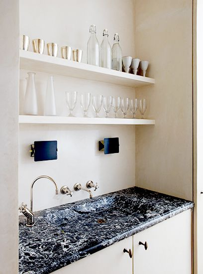 Tour Rose Uniacke's Regal London Townhouse // marble sink, open shelving, Charlotte Perriand sconces