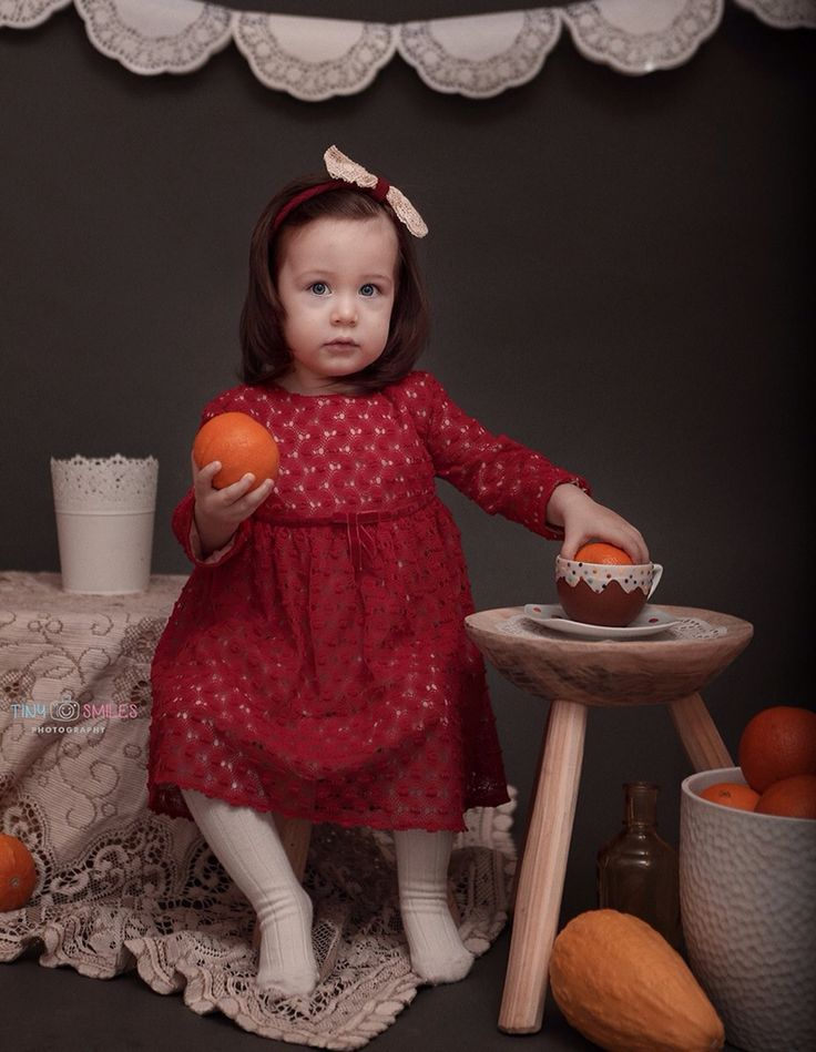 www.facebook.com/tinysmiles Toddler photography, two year old girl photo session, doily garland, oranges, kids, studio photography, Bucharest