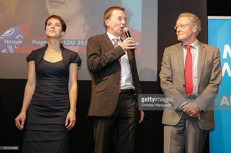 Bernd Lucke (C), head of the Euro-skeptic political party Alternative fuer Deutschland (AfD), Frauke Petry party co-spokeswoman (L) and Konrad Adam (R) party co-spokesman, react to initial exit poll results that give the party 4.9% of the vote in German federal elections at AfD party headquarters on September 22, 2013 in Berlin, Germany. Germany is holding federal elections that will determine whether current Chancellor Angela Merkel of the German Christian Democrats (CDU) will remain for a…