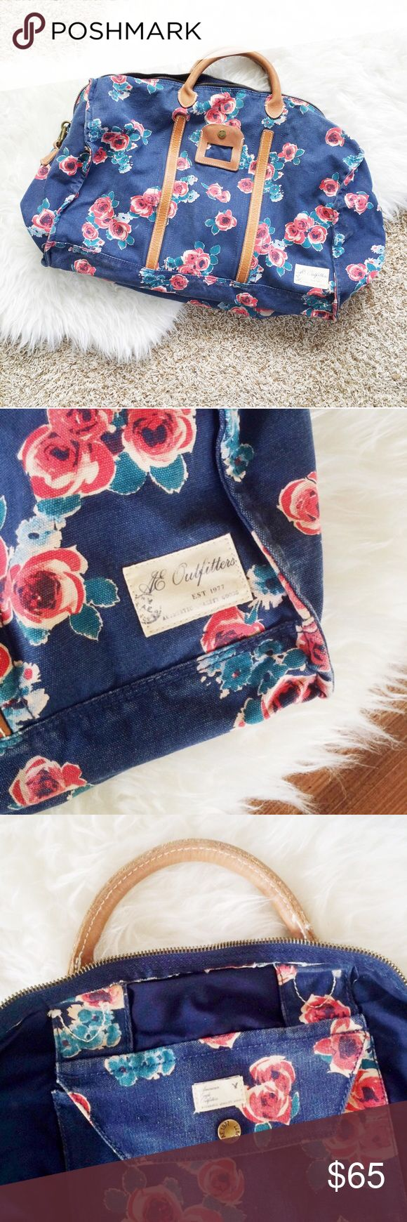 Floral Weekender Bag Navy and floral weekender bag from American Eagle. Comes with a heavy duty adjustable strap and one interior pocket. Used once, in great condition. American Eagle Outfitters Bags Travel Bags