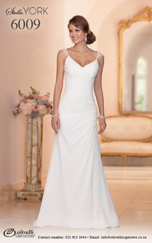 Style 6009 by Stella York is simple and oh-so elegant! Handcrafted with the most exquisite detail, this designer sheath wedding dress features whispery Lace shoulder straps and a figure flattering asymmetrical ruching throughout the bodice and hips. #StellaYork #OlivelliCT #Wedding #Gown #Dress