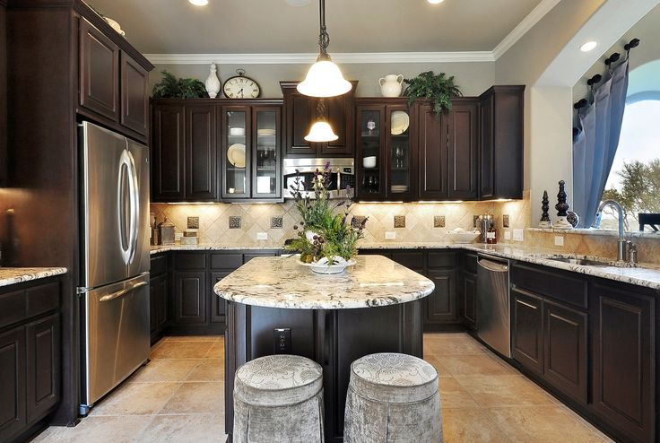 > > > YESSS, dark cabinets, grey walls, stainless steel, and that counter top looks good too! - I would change the tile floor and the backsplash.