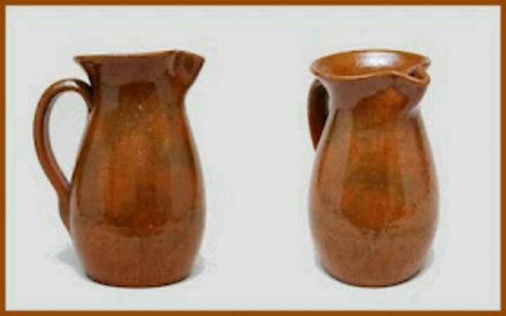 """The genuine article! A redware pitcher """"slicked"""" with a clear lead-fluxed glaze. This example, with an ice lip, was found in North Carolina, maker unknown. It displays a simple elegance of form and function. Colors in the glaze are from impurities in the clay, rather than deliberate decoration."""