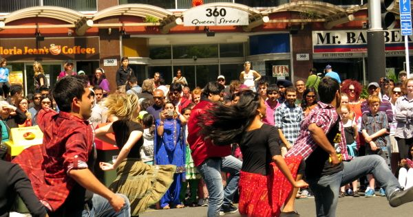 2013 Diwali Festival - flash mob Then with a dramatic beating of drums, crowds turned heads towards Queen Street where performers sprang to life with a flash-mob display of street dance with Bollywood flamboyance.