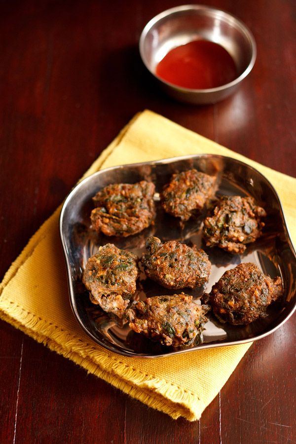 palak pakoras or spinach fritters for navratri fasting. made with kuttu ka atta or buckwheat flour.