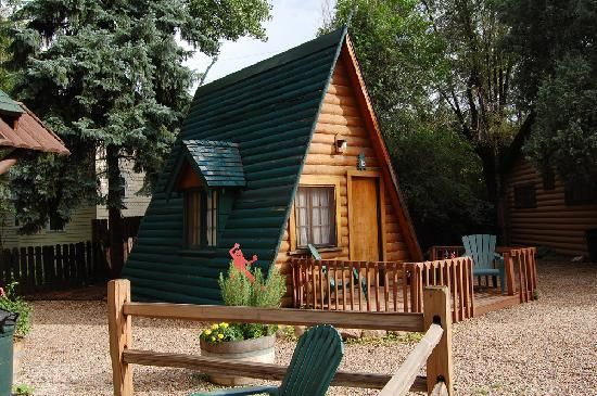 "plans for small aframe | Timber Lodge: This A-frame cabin sits next to the ""big cabin"" and ..."