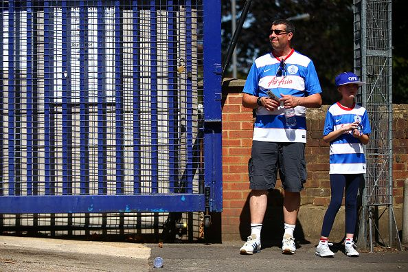 News Photo : Queen's Park Rangers fans wait outside the ground...
