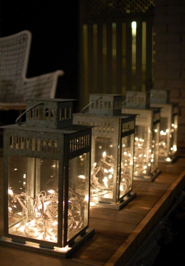Idea for porch lites if used small laterns to hang white twinkle lights / christmas lights in lanterns by jacquelyn
