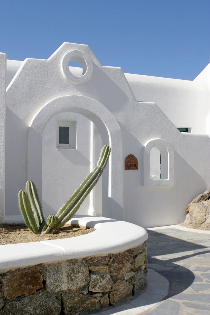 Mykonian entrance towards the hotel suites at Mykonos Grand Luxury Hotel