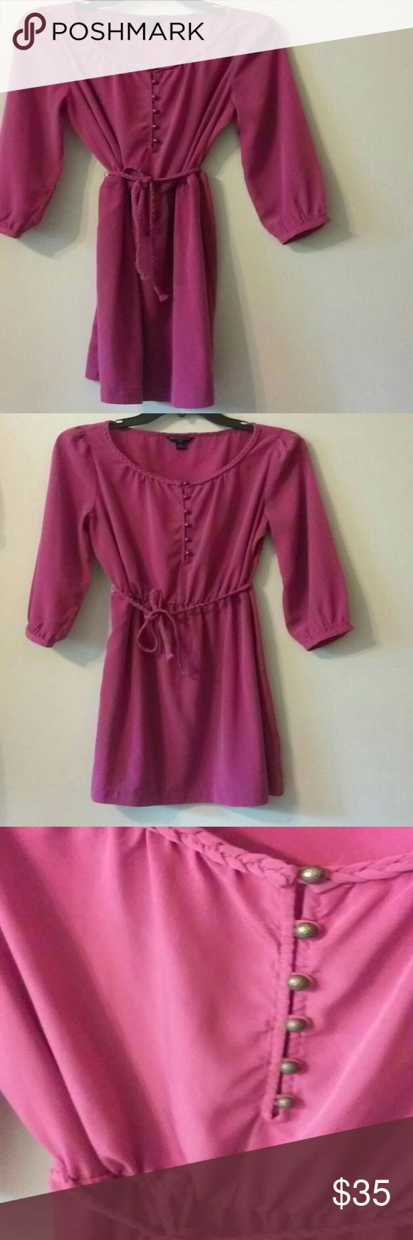 Banana republic factory dress This fushica pink dress  with a tie waist. It has 6 buttons that hook on at the top. It is an 8 petite size dress from the spring of 2012 as pictured. The dress is in great condition the only problem is the right side belt loop is broken you could re sew it or cut it off completely and still tie the belt at your hips without the loops. Price is negotiable. Banana Republic Dresses