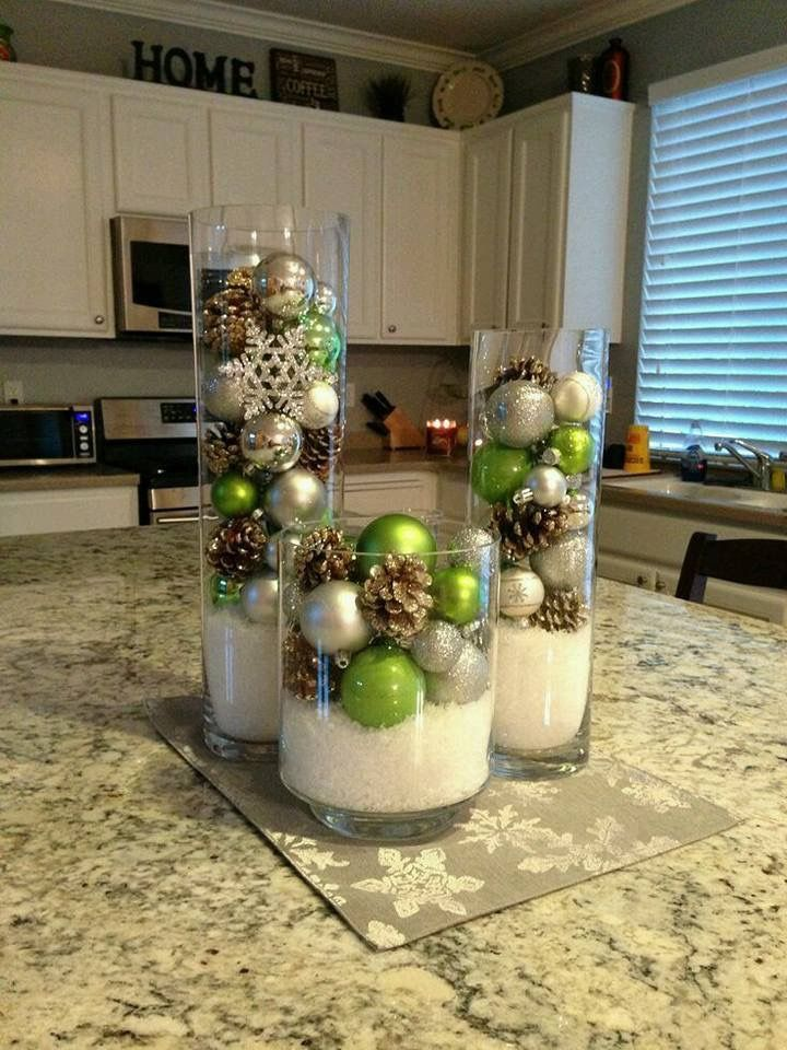 Christmas table decoration with three vases
