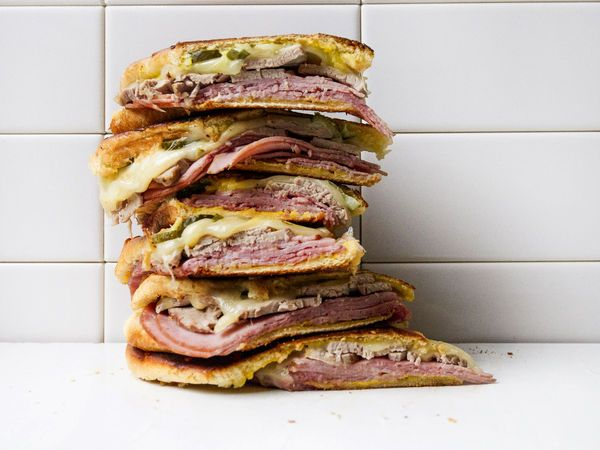 With roast pork, ham, Swiss cheese, and pickles, a medianoche is almost identical to a Cuban sandwich, save for the bread, a sweet egg load that's similar to challah. The extra richness settles the stomach just a bit more, and it develops a wonderful crust when you toast it.