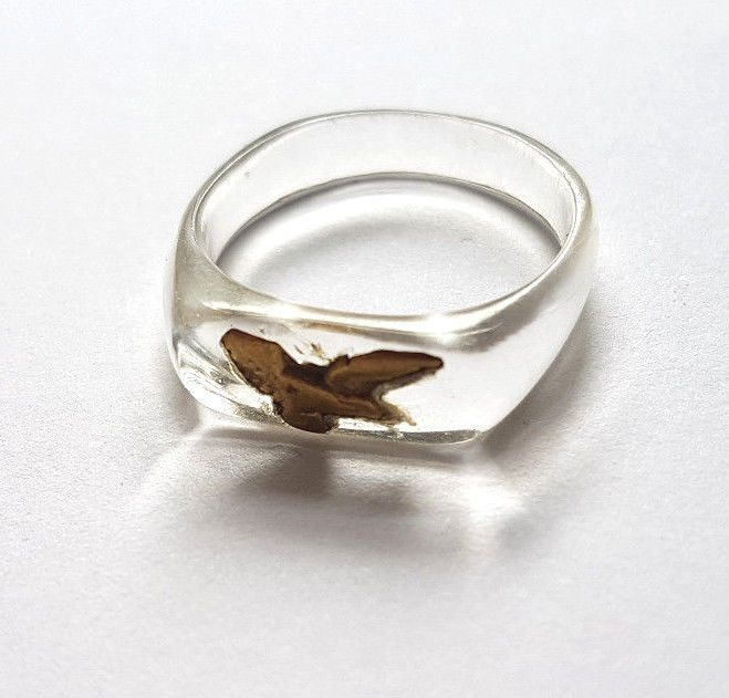 Gorgeous ring, made from lucite which famously was the plastic used in ww2 cockpit glass. It has a tiny brass?. eagle detail on the front. It does have some minor wear to the front (see pic). It is also a pretty small size. | eBay!