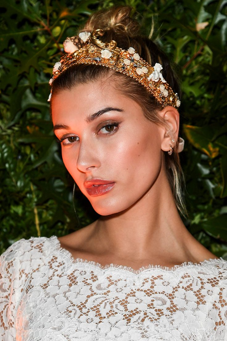 Hailey Baldwin in an ornate headband (hello bridesmaid inspiration) by Dolce and Gabbana. When you're wearing such a wow piece, trial low-key make-up and delicate earrings to let your flower-strewn, cherub-like headpiece do the talking