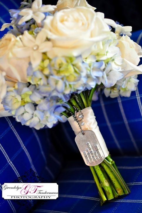 Dog tags on bouquet..sweet idea. Thinking about putting E's name tag on my bouquet to carry down the aisle with me!
