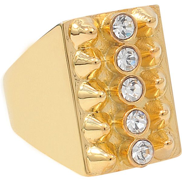 This gold ring was made by the designer brand TOM BINNS.  It is constructed with metal and Swarovski crystals.