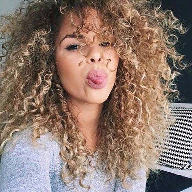 Curly permed hairstyle on long light-bronde hair