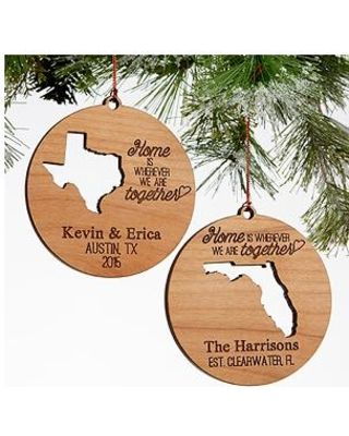 "Create a truly unique ornament for any family or couple with our exclusive ""State"" Of Love Personalized Wood Ornament.We will skillfully, laser cut out their home state on the ornament, then include any 3 lines of personalization including names, established year, city, state, address or any details you choose. ""Home is wherever we are together,"" will be included on each ornament to finish off our exclusive design. Our alder wood ornaments are a quarter of an inch thick! Improved thickness…"