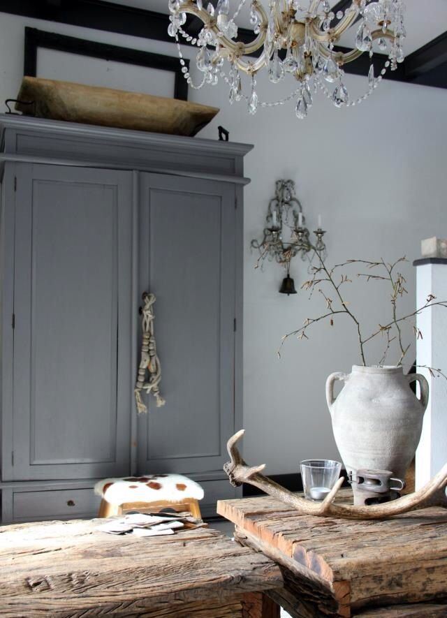 I love the combination elements.. chandelier, pottery, antlers,wood .. with a muted palette they all feel so peaceful
