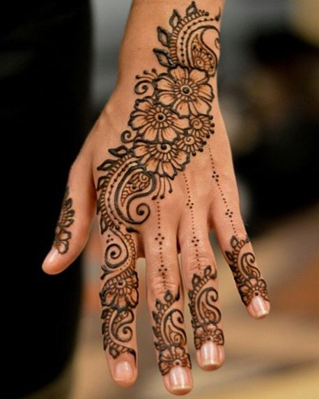 """While the mehndi is being applied, other members of the family play the traditional dhol and dance to its beats. Every female member of family gets mehndi done on her hands and feet. The entire mood of a mehndi ceremony is extremely festive."""