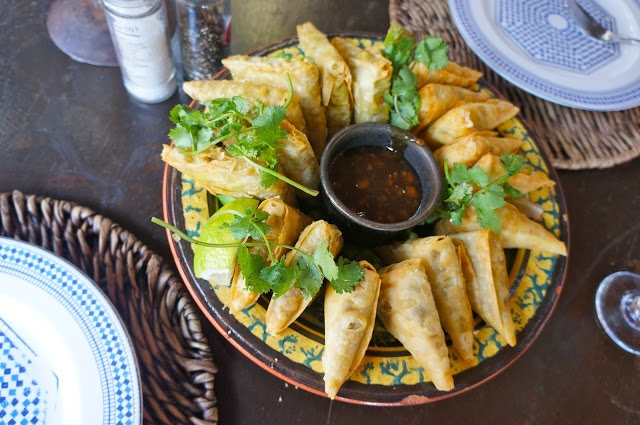 Our very first lunch in South Africa was at Moyo in Melrose Arch in Johannesburg. It's a jazzed up local place serving African stews, game, and just plain great food.   We had this big plate of samosas to share as an appetizer.