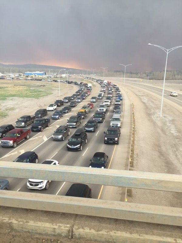 As a result of the evacuation order, the north and south roads out of Fort McMurray have been jammed with vehicles since Tuesday evening. | A Massive Alberta Forest Fire Has Forced The Evacuation Of Fort McMurray