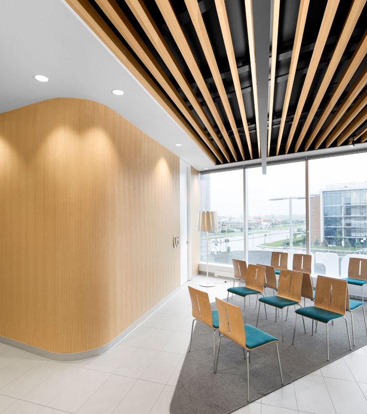 Wood And Curves Add Much To This Waiting Area Jean Lessard Architects Uniprix Commercial Interior DesignInterior Design PhotosCommercial