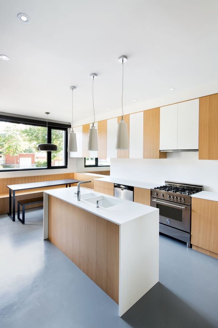 Volume House in Contemporary Black And White Concrete Design : Textures At Connaught Residence Kitchen Among Small Island Light Wood Cabinetry Also White Countertop And Backsplash