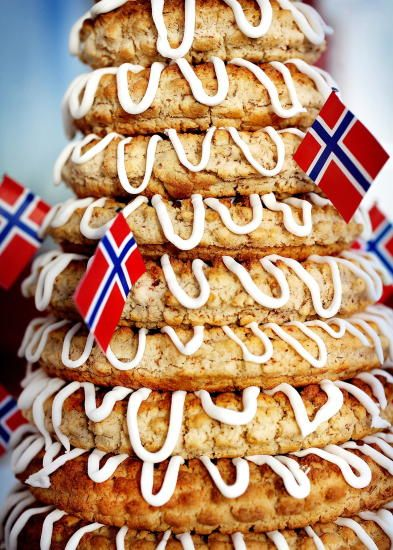 KRANSEKAKE --  for Weddings / and sometimes other holidays. Baked in sep. ring forms, assembled. A trick: a potato placed inside will help it stay fresher for a couple days. (very old wisdom) Each Scandi culture enjoys this & puts their OWN flags on a toothpick all over it. :-D